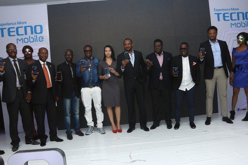 L-R: Mr Yakubu ( Consumer Protection Council); Mr Louis Njoku (SON); Jesse Oguntimehin (Tecno); Chuddy K; Hanane Kaoumi (Tecno); Mr Chidi Okwonkwo (MD, Tecno Mobile Nigeria); Mr Oye Akindehinde (Tecno); M.I. Abaga; Attai Oguche (Tecno)