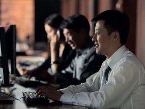 chinese man using computer